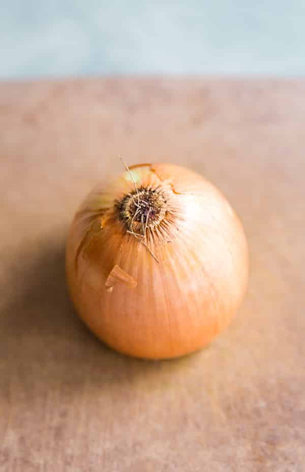 An onion on a cutting board.