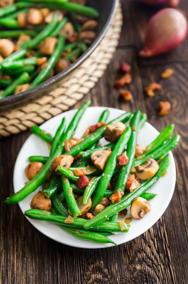 Sauteed Green Beans with Mushrooms, Shallots and Pancetta on a plate.