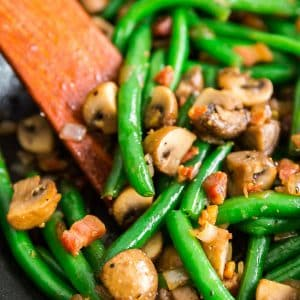 A square image of Sauteed Green Beans with Mushrooms, Shallots and Pancetta.