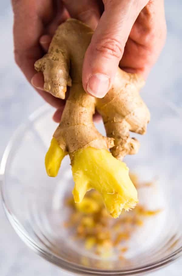 Peeled ginger in a hand.
