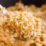 French Onion Rice Pilaf is full of savory flavor! It's a side dish that's as easy to make as it is delicious with only a little bit of work at the beginning an then you let your stove do it's thing so you can attend to the rest of your meal!