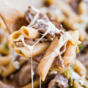 One Pot Philly Steak Pasta has all the great flavor of the famous philly cheese steak sandwiches that we all know and love, but in a quick, creamy and cheesy pasta dish that the whole family will love! Tender slices of beef, sweet bell peppers and onions sautéed together and mixed with a savory, creamy sauce, penne pasta and plenty of cheese.