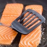 Salmon searing in a pan