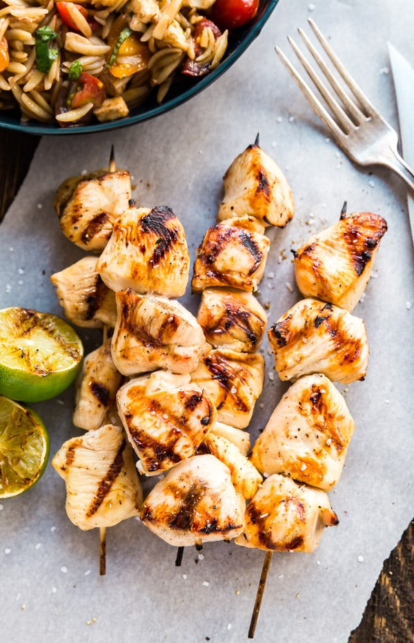 These Margarita Chicken Skewers are a serious game changer! With a deliciously fresh citrus flavor, these are perfect to grill on a hot summer night! Made with lime juice, tequila, orange juice and olive oil, these are as easy as they are delicious!