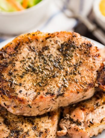 Herb Grilled Pork Chops are my absolute favorite way to enjoy grilled pork chops. Super quick and easy to make and mouthwateringly delicious (especially when dipped in applesauce!).