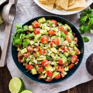 This Chunky Avocado Salsa recipe is made with a few super simple fresh ingredients and is so quick and easy to whip up last minute. You'll be making this allllll summer long!