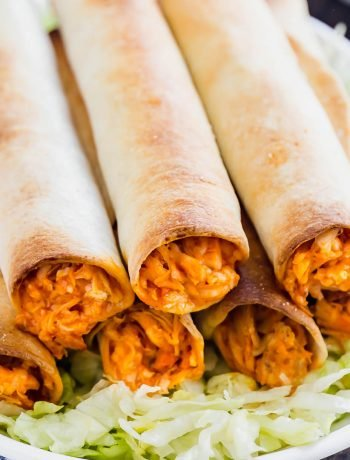 Meet your new favorite appetizer: Baked Buffalo Chicken Taquitos. Made with shredded chicken, buffalo sauce, ranch seasoning and mozzarella cheese, these are a quick and delicious way to become the most popular person at the party!