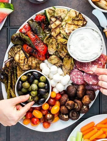 What's the best way to enjoy this gorgeous summer weather? A girl's night on the deck of course! So grab your best girlfriends and enjoy this Summer Antipasto Platter. Full of cheese, meat, olives and plenty of delicious grilled vegetables it's SO easy to make and crazy delicious!
