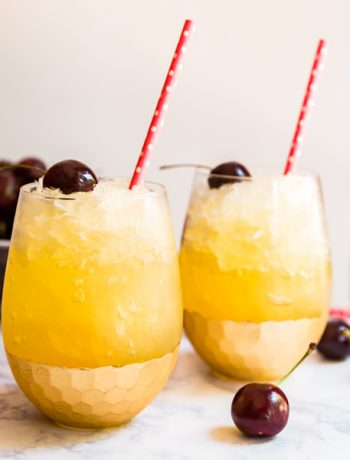 Black Cherry Lemonade Bourbon Slush is the most easy and delicious boozy recipe to bring to a party. It takes minutes to put together and then you freeze it overnight. Made with Lemonade and Red Stag Black Cherry Bourbon Whiskey, everyone goes crazy over this!