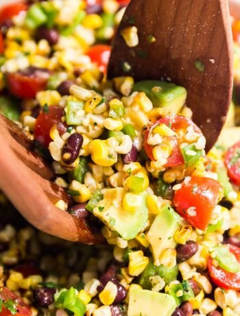 Cajun Black Bean and Corn Salad is an excellent no-mayo salad option to bring to a picnic and a great meal prep option for a light lunch you can eat all week. Made with fresh grilled corn, black beans, tomatoes, peppers, green onion and avocado with a lightly spicy cajun lime dressing, this is a new family favorite recipe!