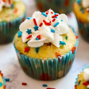 Firecracker Vanilla Cupcakes are the most fun kid's dessert the 4th of July- you'll love the POP ROCKS hidden inside for a totally fun surprise when you bite into them. These are a must-make and are SO easy!