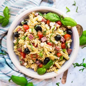 This Antipasto Italian Pasta Salad will knock your socks off! Made with rotini pasta, tomatoes, olives, fresh mozzarella, fennel, soppresata and artichoke heats, it's quick and easy to assemble and full of all the great Italian flavors, this will be your new go-to pasta salad recipe!
