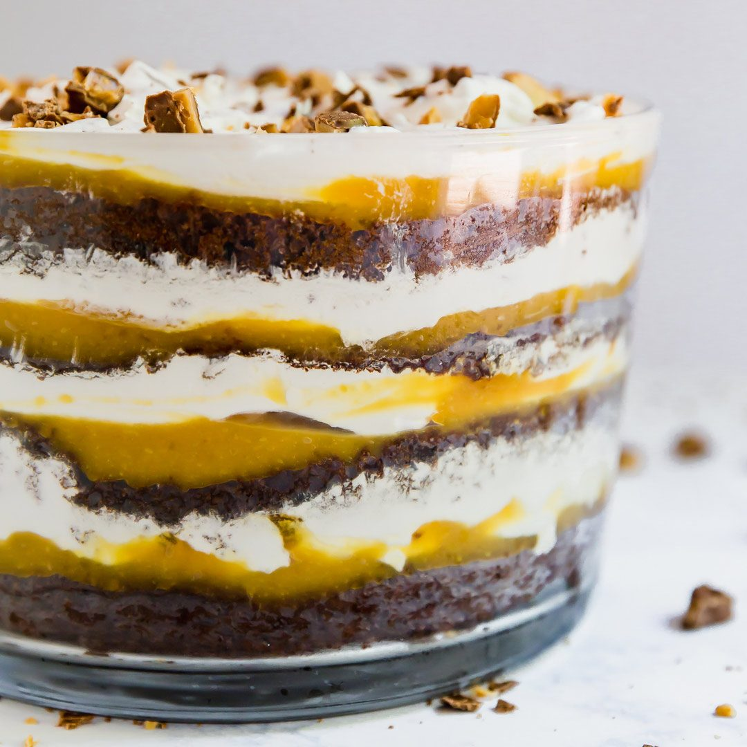 This Kahlua Toffee Chocolate Trifle Recipe is the ultimate make-ahead dessert. Made with chocolate cake, Coffee Liquor, vanilla pudding, whipped topping and toffee bars, it's so addictive that your family will be fighting for seconds!