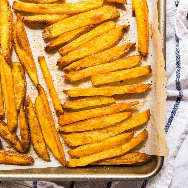 These Baked French Fries are perfectly crispy and crazy easy to make! Made with potatoes, oil and seasoning salt, these are a great weeknight side dish!