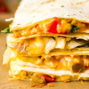You know those nights where the idea of having to get dinner on the table is just too much? Made with cheese, tortillas and whatever filling you have in your fridge, this easy Weeknight Oven Quesadilla Recipe is the solution to all your weeknight dinner woes!
