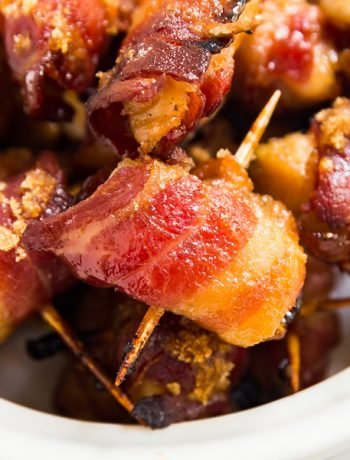 Make these Brown Sugar Bacon Wrapped Chicken Bites for your next gathering! Made with chicken, bacon, brown sugar, salt and pepper, they're a sweet and savory appetizer the whole family will love!