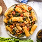 Spicy Sausage Pasta with Rapini is an easy and delicious dinner that will have everyone fighting for seconds! Made with rigatoni pasta, rapini, spicy Italian sausage and Tuttorosso San Marzano Style Chopped Tomatoes in Puree with Sea Salt, this is a definite keeper!