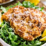 Veal Scallopini Milanese Style is a seriously easy weeknight dinner that's on the table in under 20 minutes. Made with veal cutlets, seasoned bread crumbs and Parmesan cheese, this is a light and healthy dinner that's full of delicious flavor!