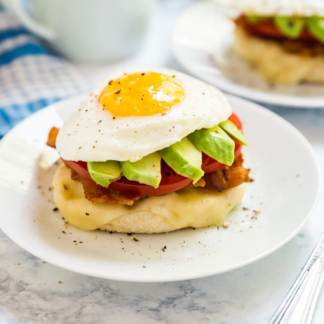This California Breakfast Stack is a delicious way to start your day- it's light, fresh and seriously easy to make! This is made with English muffins, cheese, bacon, tomatoes, avocado and eggs. You've got to try it!