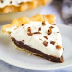 My family makes this Easy Chocolate Cream Pie over and over again. Made with chocolate pudding, pie crust and fresh whipped cream, it's effortless to put together and we always fight for seconds!