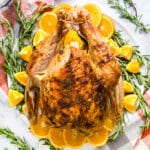 I'm so excited to share tons of information about how to cook a turkey and my recipe for Orange Rosemary Roasted Turkey! You'll find everything you need to know for making the perfect Roast Turkey for Thanksgiving from start to finish!