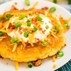 This easy loaded corn fritter recipe with all the fixings makes an easy and delicious appetizer that you will not be able to get enough of!