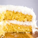 Do you love Coconut Cake? Then this is the cake for you! Perfectly moist, full of delicious flavor and crazy easy to make! Perfect for the holidays, a get together or a last minute party!