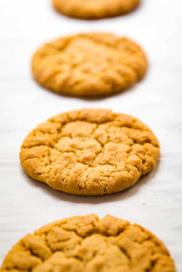 how to make peanut butter cookies and a picture of a cookie on a tray