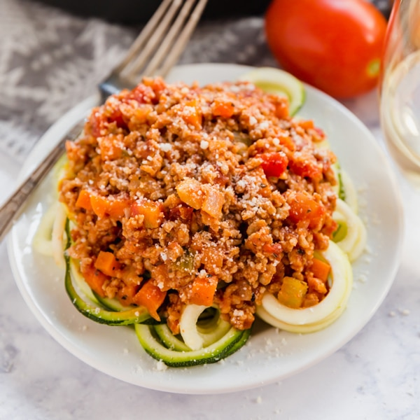 This simple Weeknight Bolognese Sauce made with ground veal comes together in less than 30 minutes and is bursting with delicious flavor! Serve it over zoodles for a carb conscious dinner that is as tasty as it is nutritious!