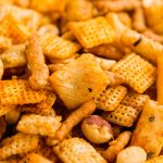 Chex Mix is everyone's favorite party mix and the addition of Sriracha kicks it up a notch in more ways than one!