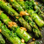A close up photo of asparagus in a pan.