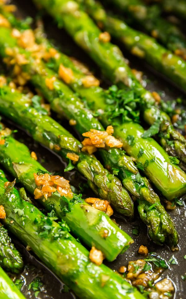 A close up photo of asparagus in a pan