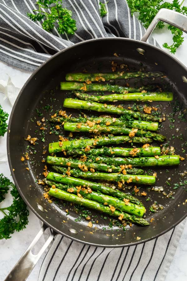 An overhead image of sautéed asparagus in a pan