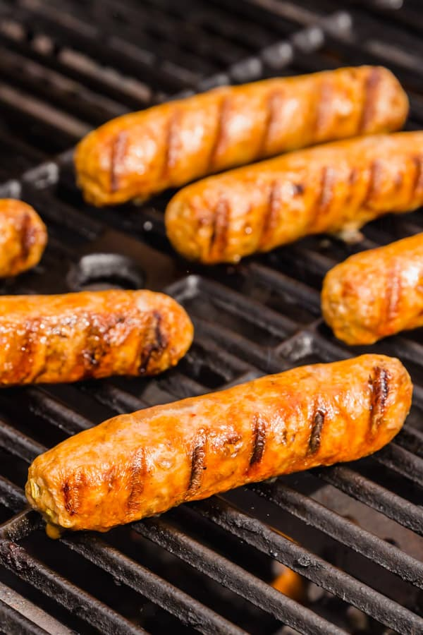Italian sausage on a grill.