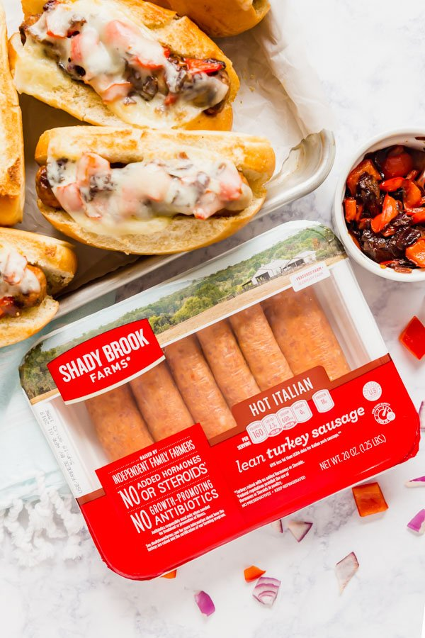 A Package of Shady Brook Farms Hot Italian Turkey Sausage links with the cooked sandwiches next to them