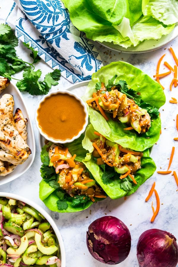 An overhead images of thai lettuce wraps surrounded by ingredients