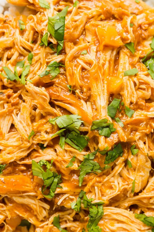 A close up image of shredded instant pot pineapple chicken.