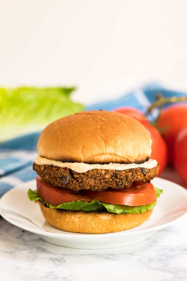 A straight on image of a bean burger recipe on a bun.