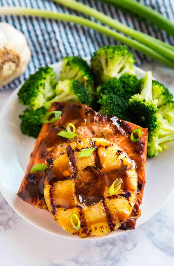 The Hawaiian grilled salmon recipe on a plate with a side of broccoli.