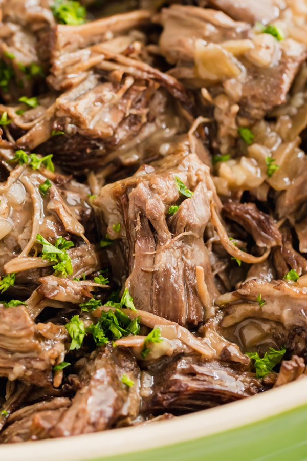 A close up image of a piece of shredded pressure cooker pot roast
