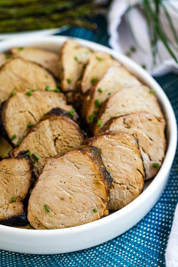 Slcies of pork tenderloin on a plate.