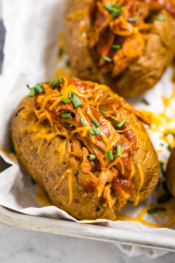 A close up photo of a stuffed baked potato
