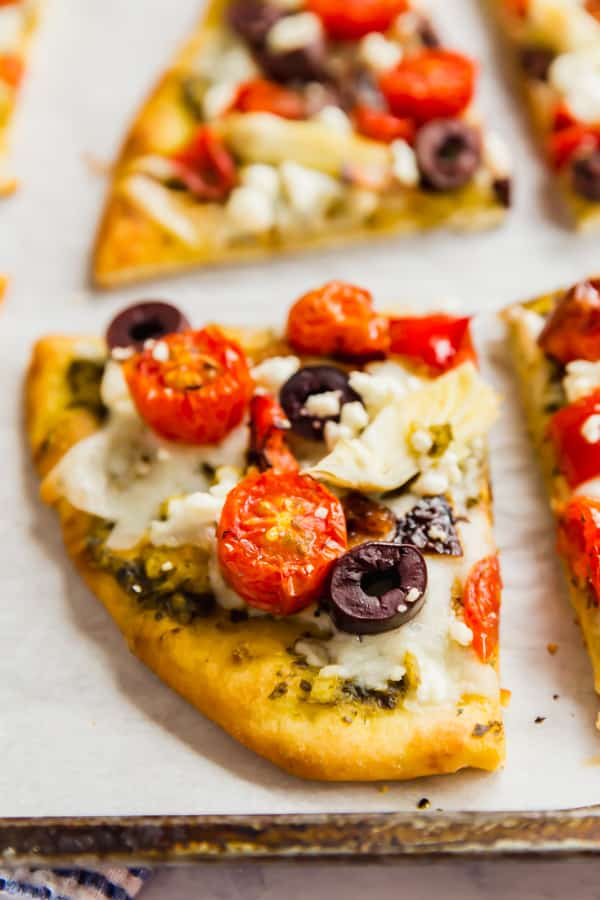 A close up of roasted vegetable flatbread