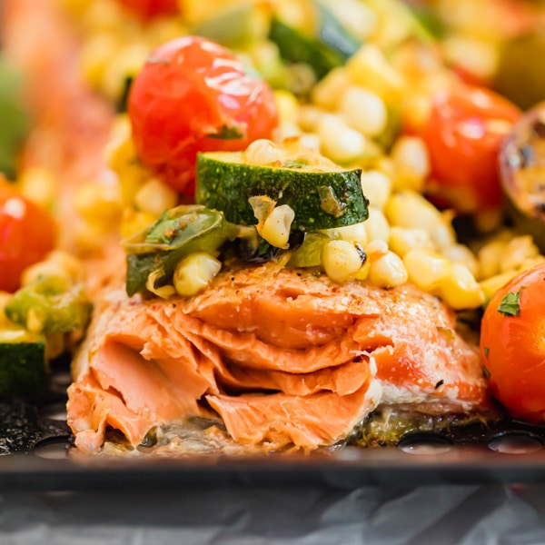 This Grilled Salmon Recipe with Summer Vegetable Relish will make you want to grill all year around- it's super quick and easy to make for a fresh dinner you'll love!