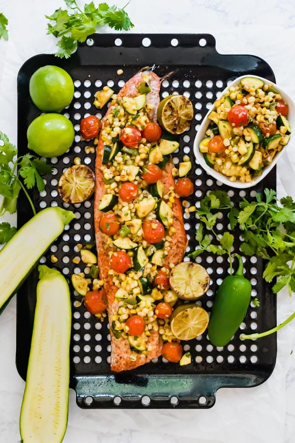 An overhead image of this grilled salmon on a pan with the relish on top.