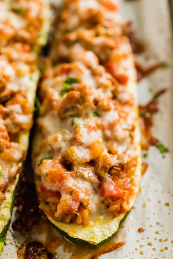 A close up image of zucchini boats on a pan