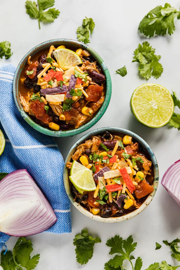 An overhead image of bowls of chicken chili.