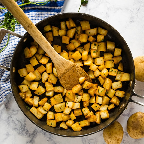If the perfect potato is crispy on the outside and light and fluffy then these Fried Potatoes definitely deliver. They're quick and easy with seriously delicious flavor!