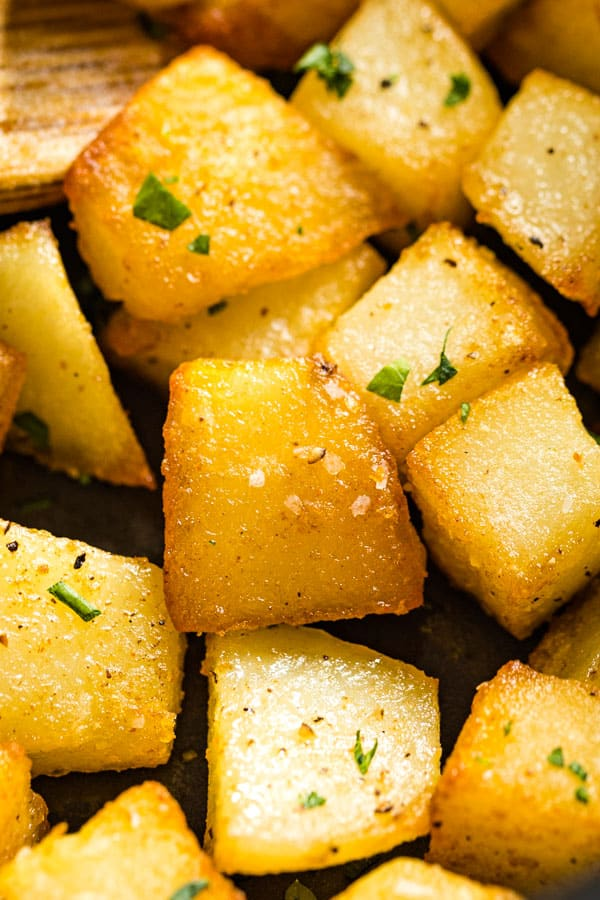 An estreme close up of some pan fried potatoes