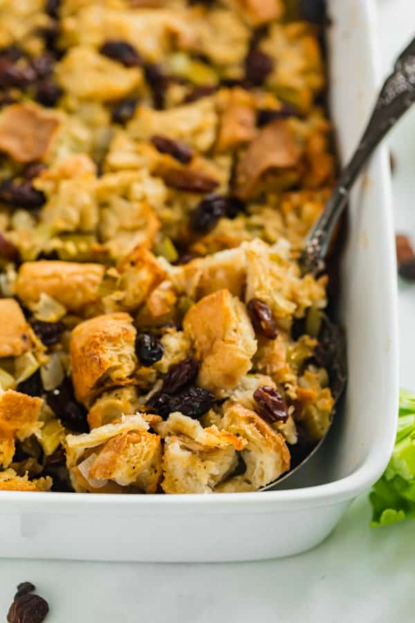 A spoon in a pan of dressing for Thanksgiving